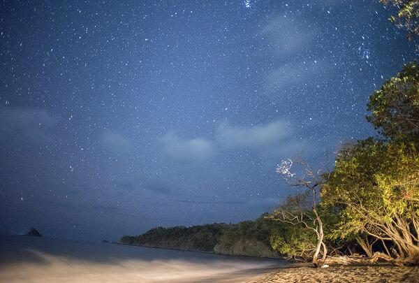 A firelit beach dinner at Playa Danta offers a chance to connect to a more natural rhythm